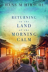 Cover for Returning to the Land of the Morning Calm by Hans M. Hirschi Korean small town road leading to a rising sun behind some hills